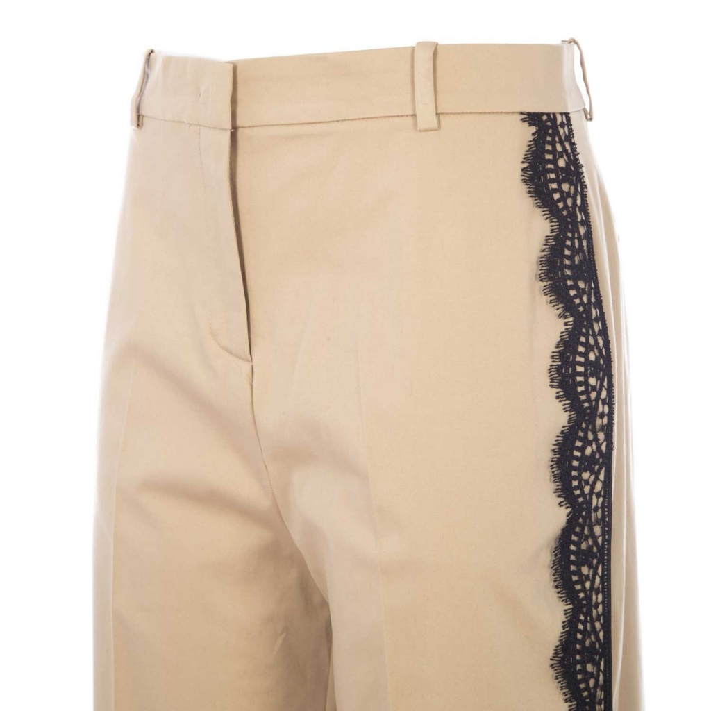 Beige trousers with black lace details on the side parts C74